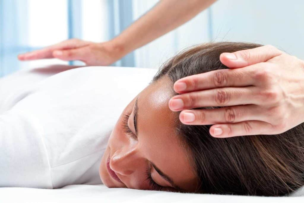 woman deeply relaxed in a reiki treatment
