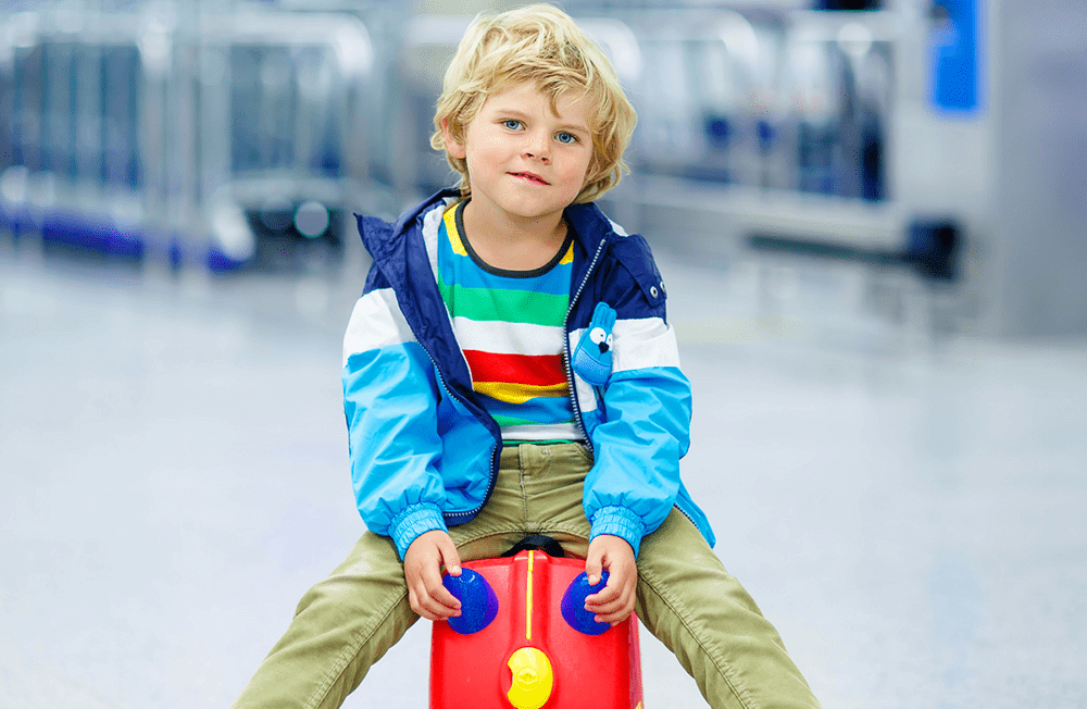 Kid with suitcase at airport