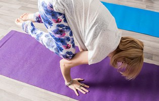 Woman doing yoga crow pose