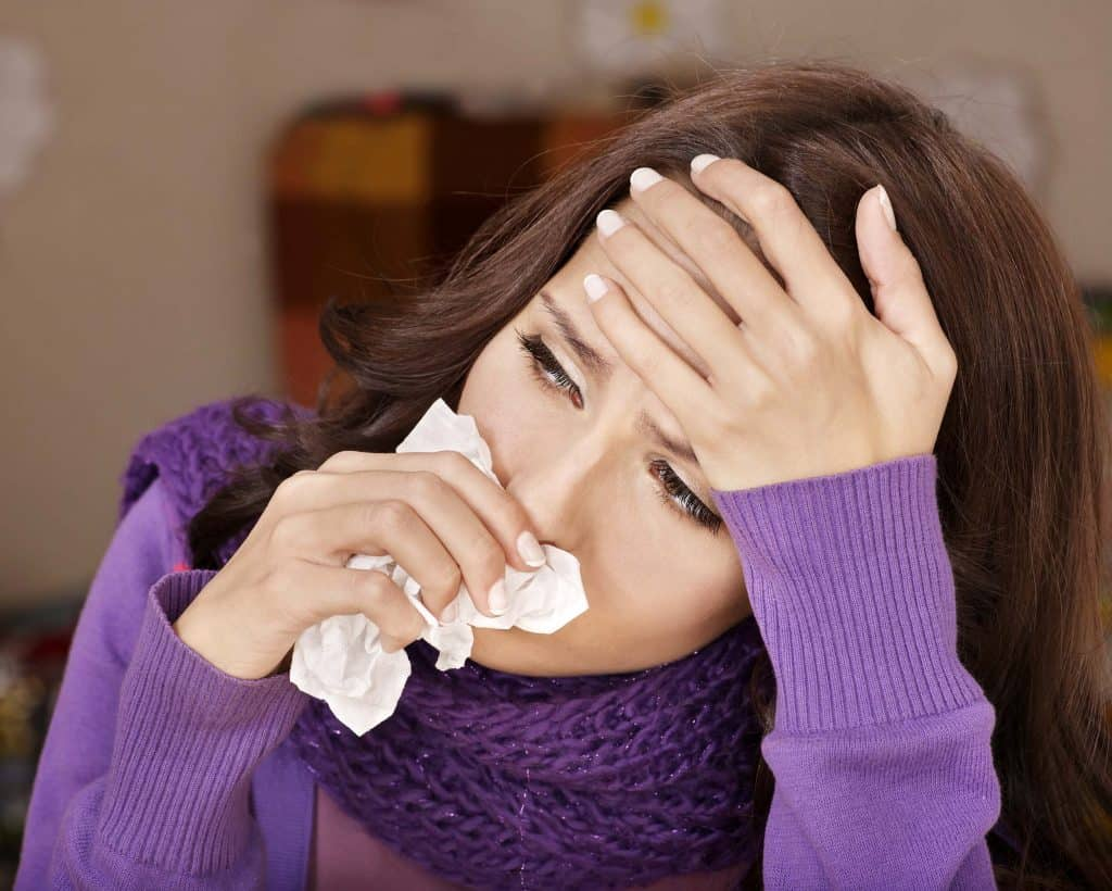 Woman with cold and mucus looking miserable