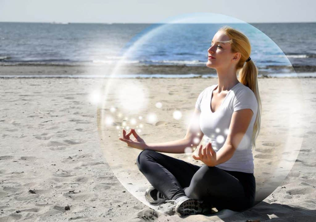Woman on a beach in a happy mindful bubble