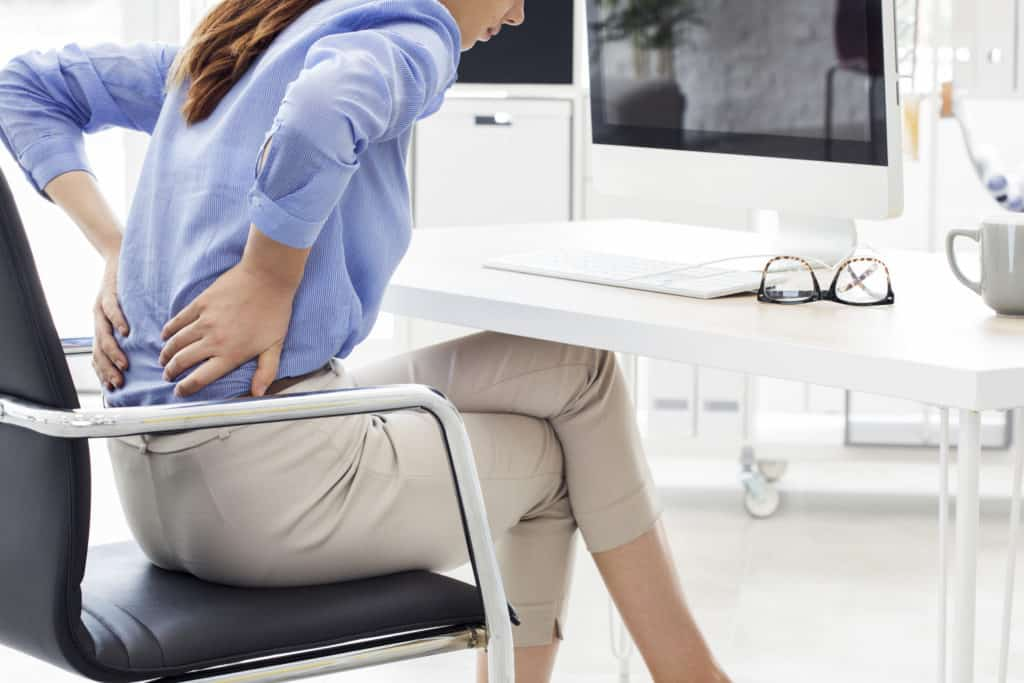 Woman suffering from acute back pain