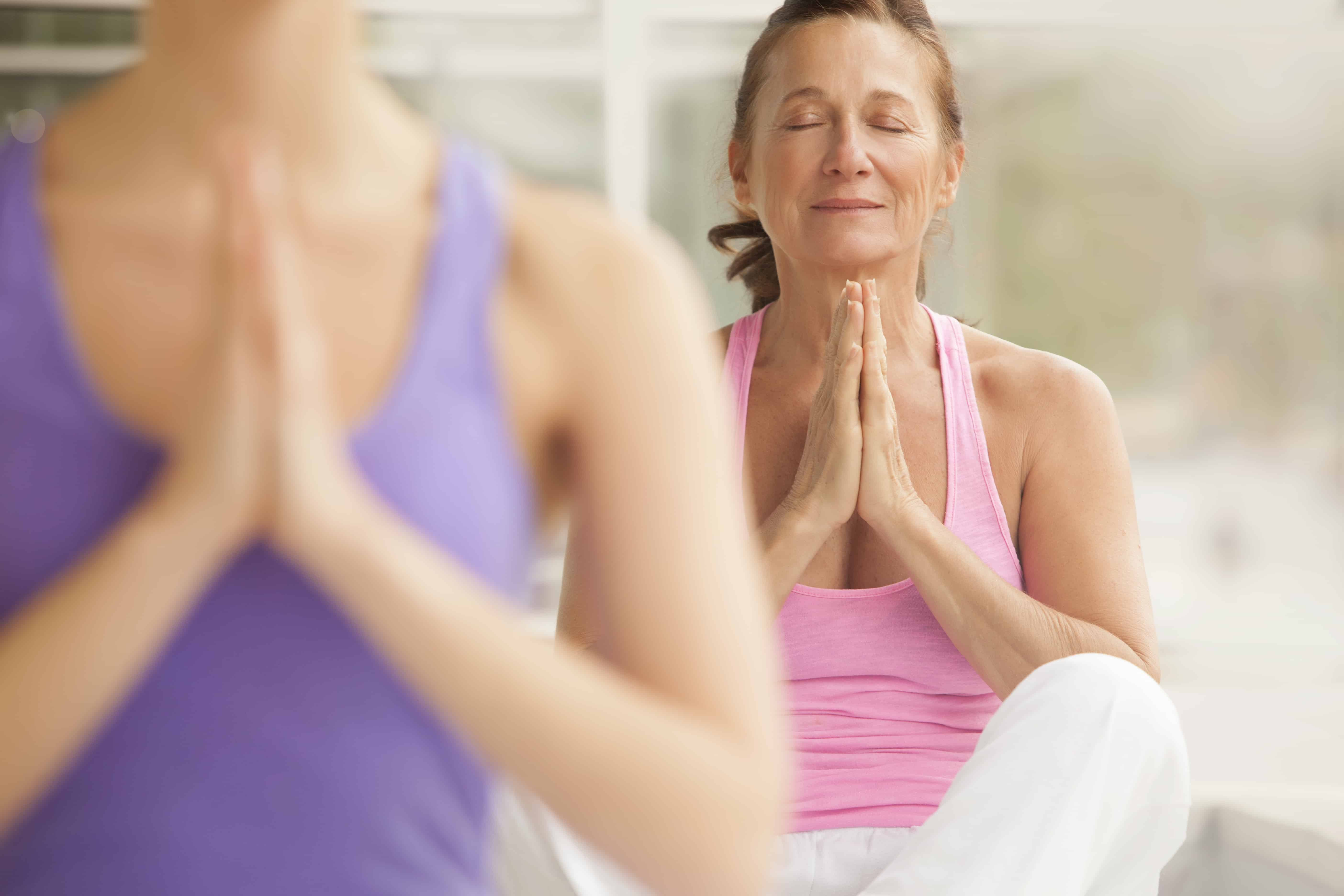 Older lady in yoga class