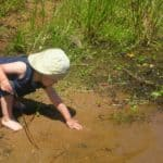 Chid playing in mud
