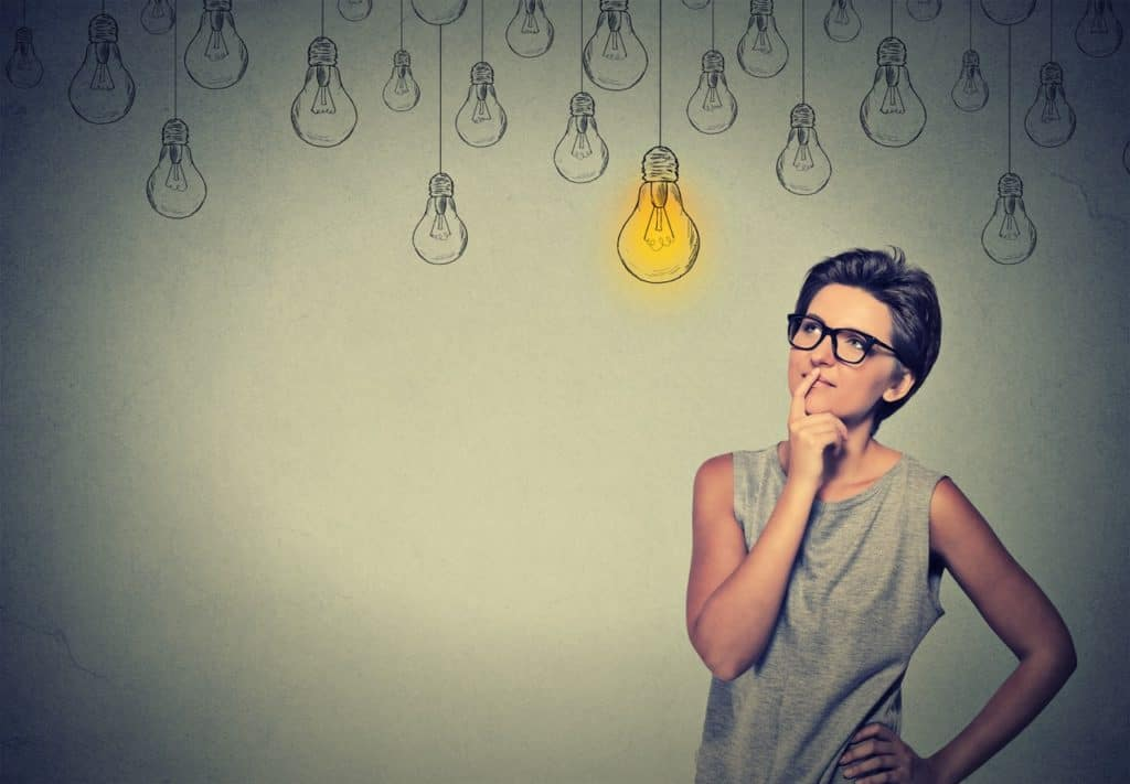 Woman thinking about new year resolutions, having a lightbulb moment