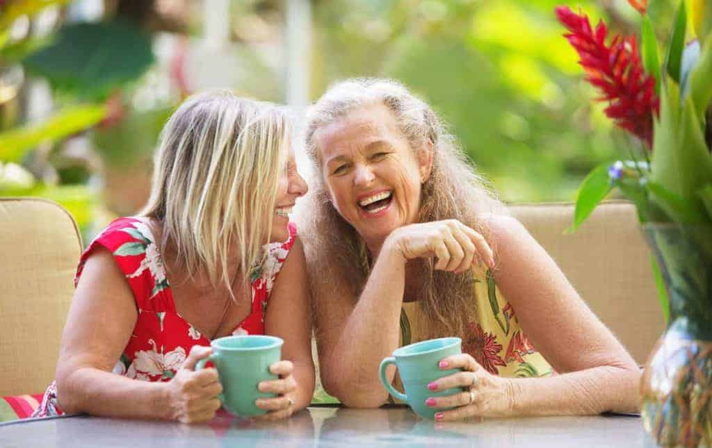 Two friends are laughing, definition of how to be happy